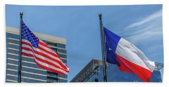 American And Texas Flag On Top Of The Pole Beach Towel