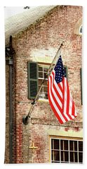Beach Towel featuring the photograph American Flag In Colonial Williamsburg by Emanuel Tanjala