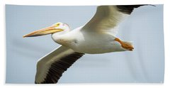 Beach Sheet featuring the photograph  American White Pelican Flyby  by Ricky L Jones