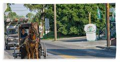 Beach Towel featuring the photograph Amish Girl On The Road by Patricia Hofmeester