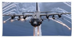 An Ac-130h Gunship Aircraft Jettisons Beach Towel