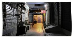 Beach Towel featuring the photograph An Alley In Mahane Yehuda Market by Dubi Roman