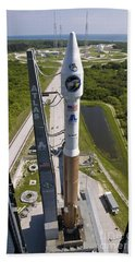An Atlas V Rocket On The Launch Pad Beach Towel by Stocktrek Images