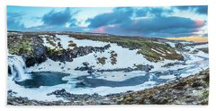An Icy Waterfall Panorama During Sunrise In Iceland Beach Sheet by Joe Belanger