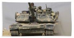 An M1a1 Abrams Tank Heading Beach Towel