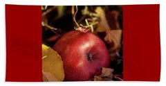 Apple In The Leaves Beach Towel