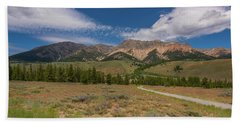 Approaching The Sawtooth Mountains Beach Towel