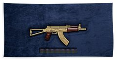 Beach Towel featuring the digital art Gold A K S-74 U Assault Rifle With 5.45x39 Rounds Over Blue Velvet by Serge Averbukh