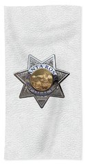 Beach Towel featuring the digital art Santa Rosa Police Department Badge Over White Leather by Serge Averbukh