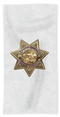 Beach Sheet featuring the digital art Marin County Sheriff Department - Deputy Sheriff Badge Over White Leather by Serge Averbukh