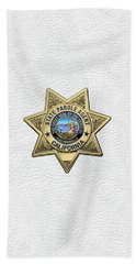 California State Parole Agent Badge Over White Leather Beach Sheet by Serge Averbukh