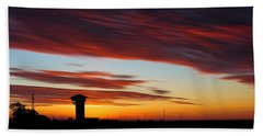 Sunrise Over Golden Spike Tower Beach Towel by Bill Kesler