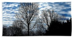 Ash Trees Against A Mackerel Sky Beach Towel