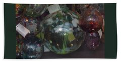 Beach Towel featuring the photograph Assorted Witching Balls by Suzanne Gaff