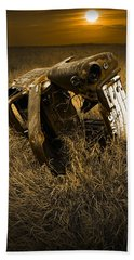 Auto Wreck In A Grassy Field On The Prairie At Sunset Beach Towel