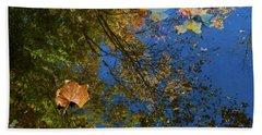 Beach Towel featuring the photograph Autumn Leaf Reflections by Lon Dittrick