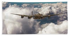 Beach Towel featuring the photograph Avro Lancaster Above Clouds by Gary Eason