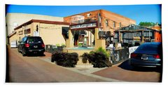 Back Alley View Of The Gaslight Inn Patio Beach Towel by Charles Ables