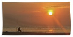 Baiting The Hook At Sunrise Beach Towel