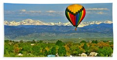 Ballooning Over The Rockies Beach Towel