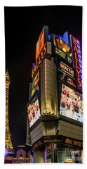 Beach Towel featuring the photograph Ballys Sign In Front Of The Eiffel Tower At Night by Aloha Art