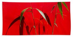 Bamboo Against Red Wall Beach Towel