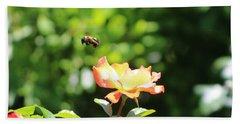Bee Flying From Peach Petal Rose Beach Towel