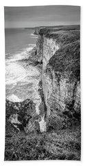 Bempton Cliffs Beach Towel by Nigel Wooding