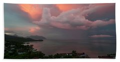 Between Rainstorms Beach Towel