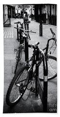 Bicycles In A London Street Beach Towel by Lynn Bolt