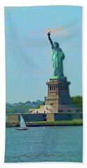 Big Statue, Little Boat Beach Towel