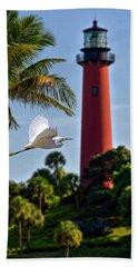 Bird In Flight Under Jupiter Lighthouse, Florida Beach Towel by Justin Kelefas