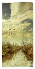 Birds Flying Over A River Beach Towel by Jill Battaglia