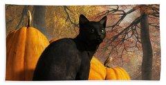 Black Cat At Halloween Beach Towel by Daniel Eskridge