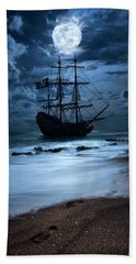 Black Pearl Pirate Ship Landing Under Full Moon Beach Towel by Justin Kelefas