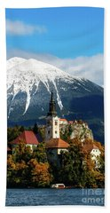 Bled Lake With Snow On The Mountains In Autumn Beach Towel