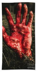 Blood Stained Hand Coming Out Of The Ground At Night Beach Towel