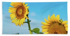 Blooming Sunflower In Blue Sky Beach Towel