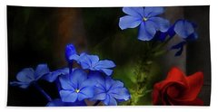 Blue Flowers Growing Up The Apple Tree Beach Towel
