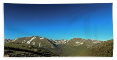 Blue Skys Over The Rockies Beach Towel