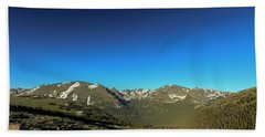 Blue Skys Over The Rockies Beach Towel