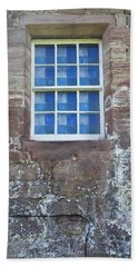 Beach Towel featuring the photograph Blue Squares In The Castle Window by Christi Kraft