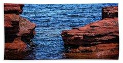 Blue Water Between Red Stone Beach Towel