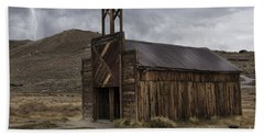 Beach Towel featuring the photograph Bodie Fire Station With Lightning by Sandra Bronstein