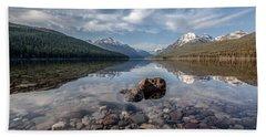 Bowman Lake Rocks Beach Sheet by Aaron Aldrich