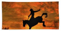 Bronco Riding Sunset Beach Towel