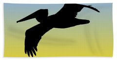 Brown Pelican In Flight Silhouette At Sunrise Beach Towel