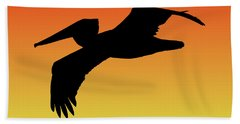 Brown Pelican In Flight Silhouette At Sunset Beach Towel