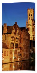 Beach Towel featuring the photograph Bruges Belfry At Night by Barry O Carroll