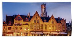Beach Towel featuring the photograph Burg Square Architecture At Night - Bruges by Barry O Carroll